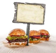 Home made hamburgers with blank blackboard Stock Photos