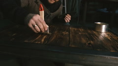Carpenter handles the tabletop. Close-up - stock footage