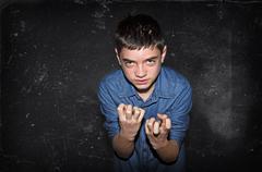 Aggressive boy Stock Photos