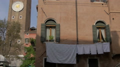 Clothes drying on a clothes line on a building on Strada Nuova, Venice Stock Footage