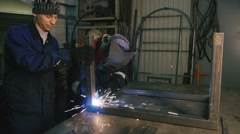Stock Video Footage of Two men are working  with welding apparatus. Close-up