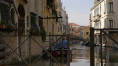 Canal with boats and iron bridges in Venice - stock footage