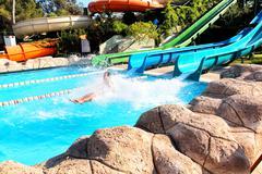 Women having fun in aqua park - stock photo