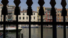 Grand Canal seen behind a cast iron fence with spears, Venice Stock Footage
