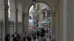Tourists walking on an outside corridor in Venice Stock Footage