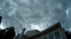 Dark Ominous Clouds moving through sky over house - stock footage
