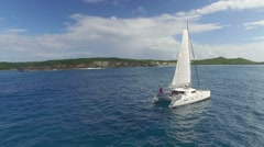 View of sailboat cruising on caribbean sea - stock footage