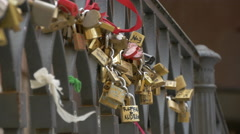 Stock Video Footage of Padlocks chained to a bridge in Venice