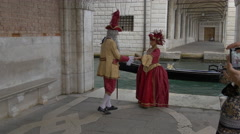 One couple in medieval costumes posing for picture in Venice Stock Footage