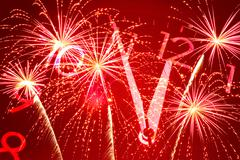 Five minutes to twelve and firework Stock Photos