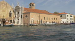 Three boats moving along a church with statues in Grand Canal, Venice Stock Footage