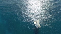Aerial view of sailboat cruising on caribbean sea Stock Footage