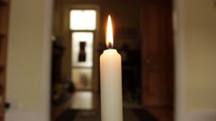Lit candle burns briefly and then is blown out. Stock Footage