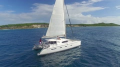 View of sailboat cruising on caribbean sea Stock Footage