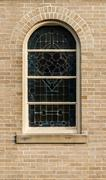 windows in  Neo-Gothic style whith mosaic - stock photo