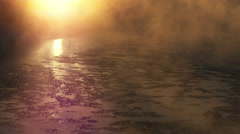 Early morning mist on a cold winter day coming off a river during sunrise Stock Footage