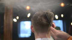 Barber Makes Styling Hair With Spray. Water Droplets Fly Beautifully On Stock Footage