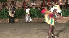 African tribe dancers, tribesmen tribeswomen dance sing songs drum jump clap Stock Footage