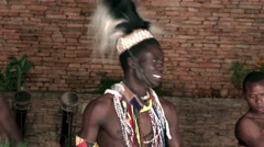 African tribe warrior dancers, tribesmen dance sing songs drum jump clap Stock Footage