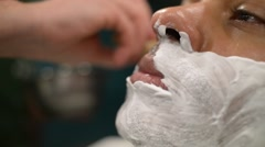Barber Applied To The Face Shaving Foam By A Swab - stock footage