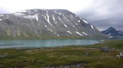 Trekker by his tent, Jotunheimen, norway Stock Footage