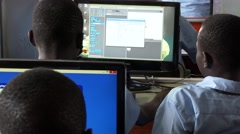 Rear shot of African students at computer lab in school-Education in Africa - stock footage