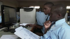 Side view of African students at computer lab of school - Education in Africa - stock footage