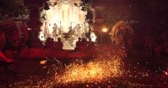 Village men push coals fire walking dance  performance Hindu temple Ubud, Bali Stock Footage