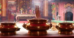 Bowls of burning incense offering Malaysia Stock Footage