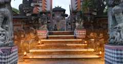 Hindu temple with statues and lit candles Ubud, Bali Stock Footage