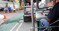Tuk Tuk cab driver in Bangkok Thailand Stock Footage