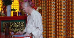 Buddhist monk recites prayers Penang Malaysia - stock footage