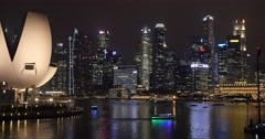 Cityscape at night with boats Singapore Stock Footage