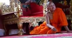 Buddhist monk child in temple Pai, Northern Thailand, Mae Hong Son Stock Footage