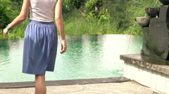 Young woman stretching her arms by pool, super slow motion 240fps Stock Footage