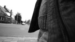 Male walking urban winter flycam Stock Footage