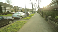 Walking sidewalk  suburbs point of view Stock Footage