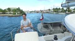 Skipper leaving the marina for cruising day Stock Footage