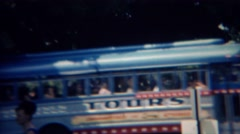 1968: Colorful retro style tour bus passes city park patrons. GETTYSBURG, PENN. Stock Footage