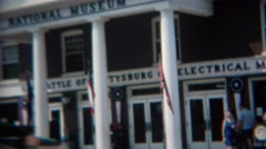 1968: Family at national museum looks at map window display. GETTYSBURG, PENN. Stock Footage