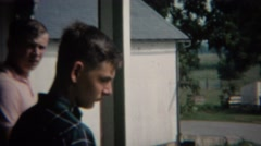 1968: Teenager brothers living in rural farmland America with kiln stoves.   Stock Footage