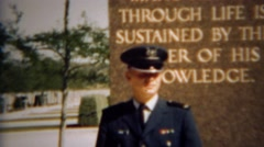 1966: Family joins military cadet as mission statement statue.  U.S. AIR FORCE Stock Footage