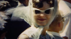 1966: Early 60's style women white sunglasses headscarf fashion look.  DENVER, - stock footage