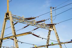 Stock Photo of Overhead line wire over rail track. Power lines.