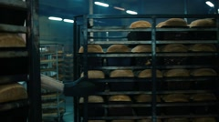 Manufacture of fresh baked bread in a bakery oven Stock Footage