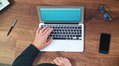 Man working with Laptop on Vintage Wooden desktop Stock Footage