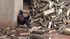 African lumberjack labor resting after hard working day in a sawmill-lumber Stock Footage