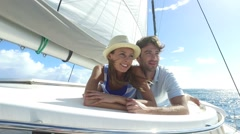 Couple laying on a sailboat deck during cruise Stock Footage
