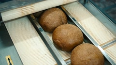 machine cuts into slices fresh bread rolls manufacturer - stock footage
