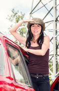 Adventurous brunette wearing green safari hat, outdoors environment standing in Stock Photos